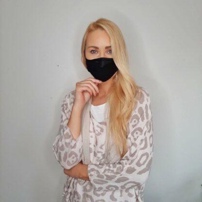 Urusla wearing the small adult black silk mask
